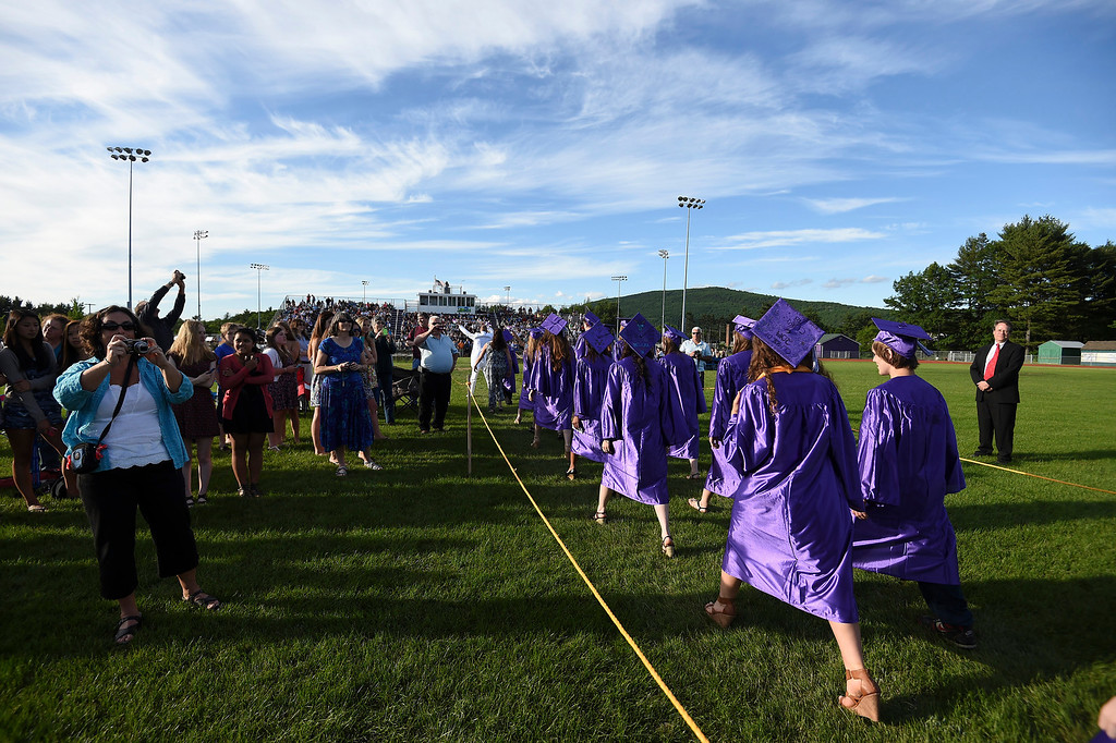 Description of . Kayla Rice/Reformer Graduating seniors file in during the BUHS graduation ceremony on Friday evening.