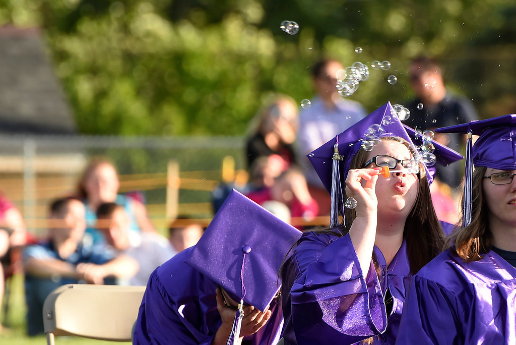 Description of . Kayla Rice/Reformer A graduating senior blows bubbles during the BUHS graduation ceremony on Friday evening.