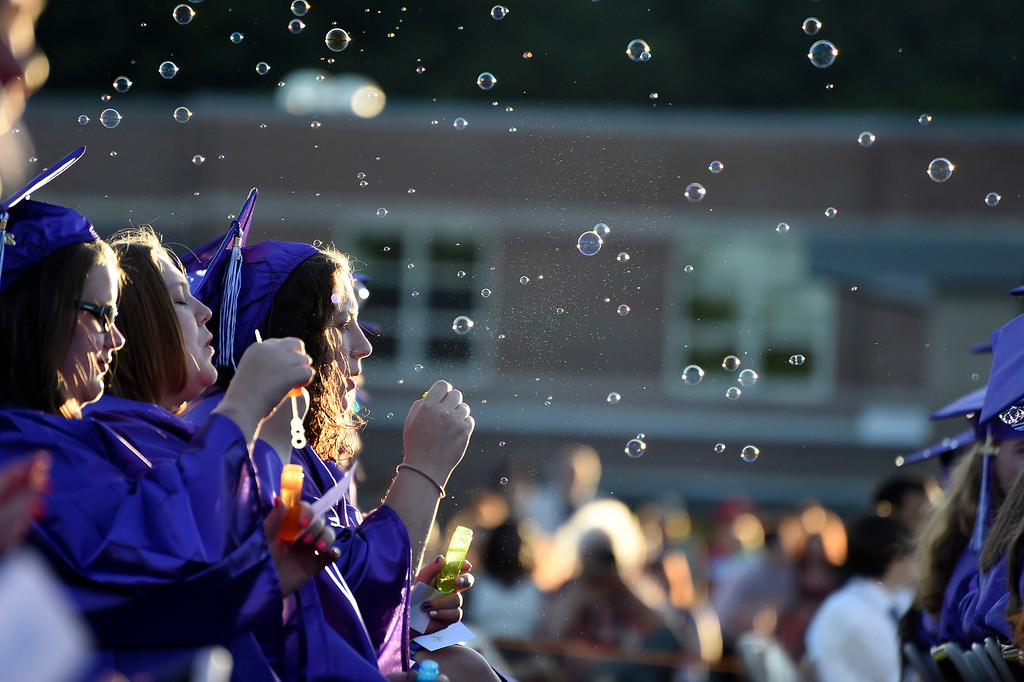 Description of . Kayla Rice/Reformer Bubbles fill the air during the BUHS graduation ceremony on Friday evening.