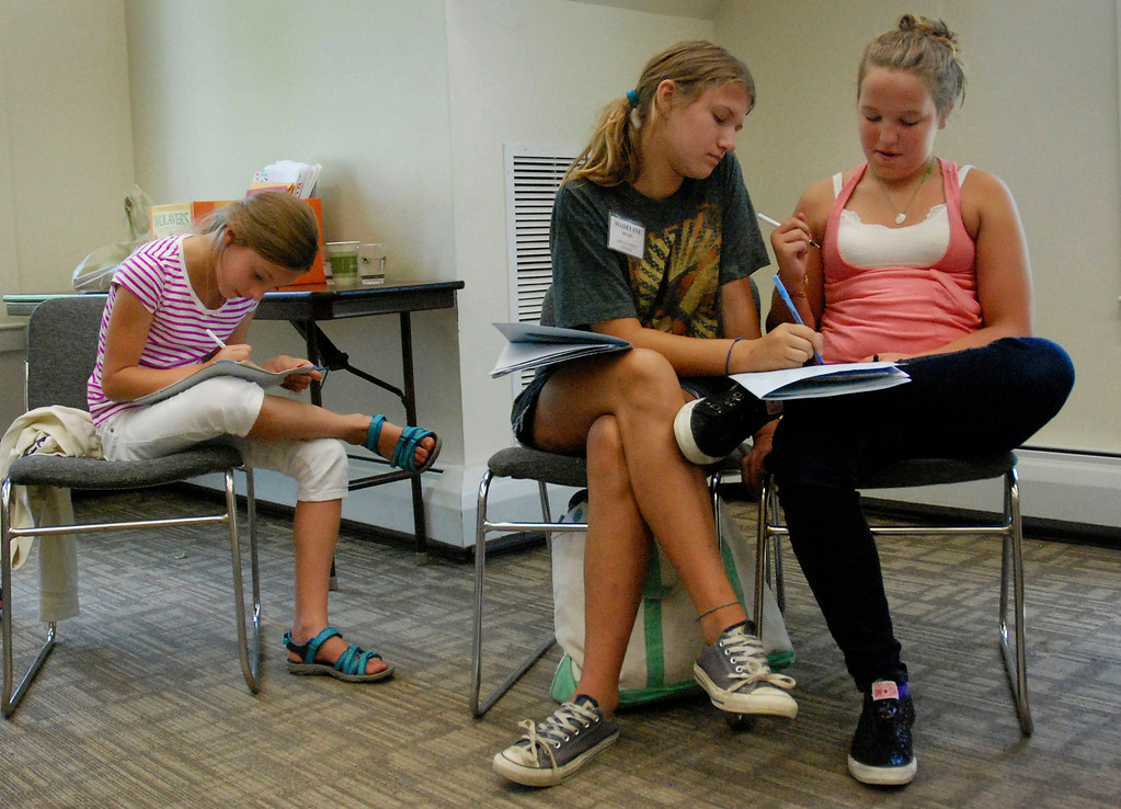 Description of . Kayla Rice/Reformer                                 (From left) Alexandra Miskovich, Madeline Brady and Lauryn Sargent work during the WSESU middle school leadership conference at SIT on Tuesday.