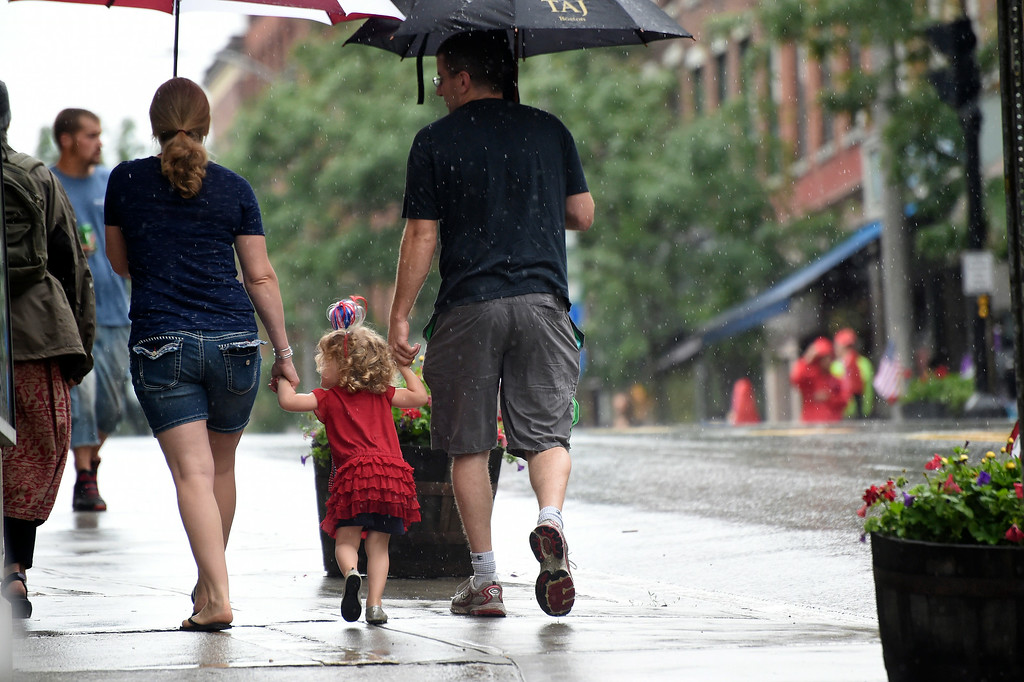 Description of . Kayla Rice/Reformer Hannah, 2, of Turners Falls, Mass. walks with her parents before the Brattleboro Fourth of July parade on Friday.