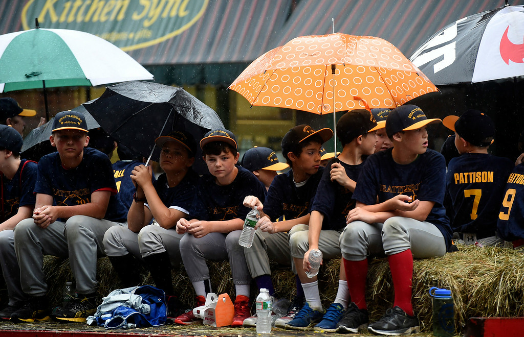 Description of . Kayla Rice/Reformer The Brattleboro Little League All Stars ride on a float in the Brattleboro Fourth of July parade on Friday.