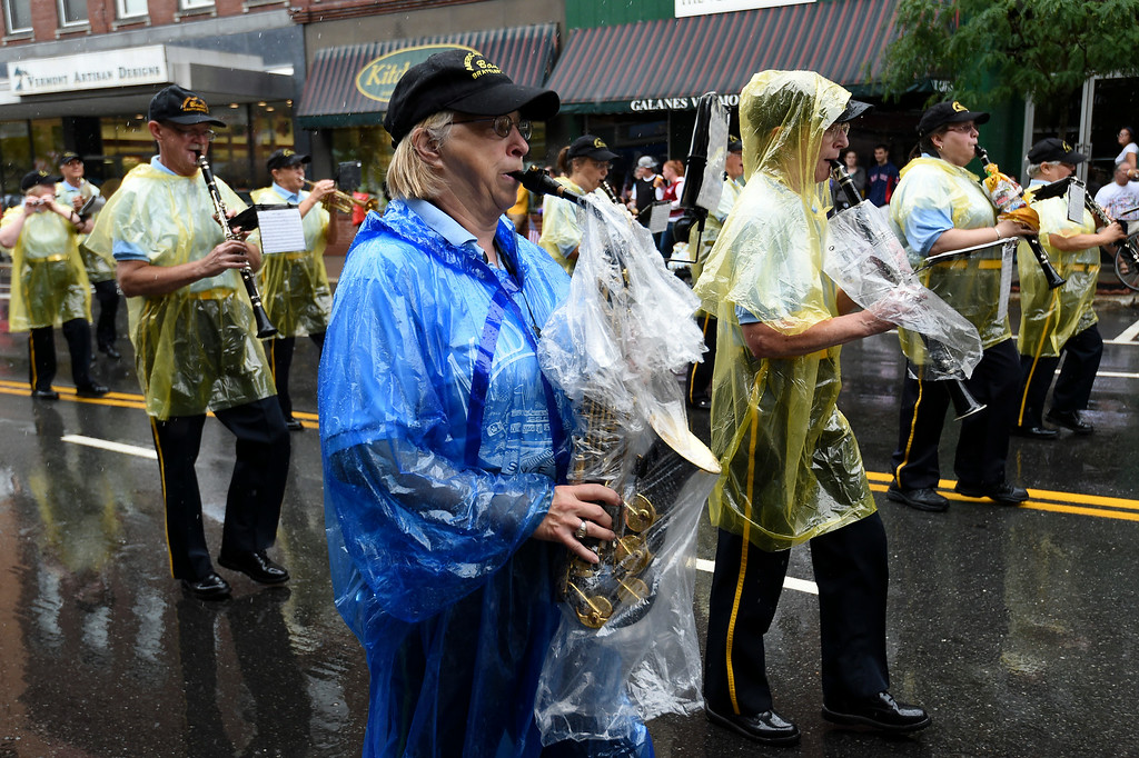 Description of . Kayla Rice/Reformer The American Legion band braves the wet weather to march in the Brattleboro Fourth of July parade on Friday.