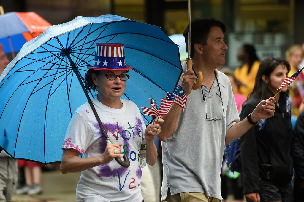 Description of . Kayla Rice/Reformer Valarie Stuart walks in the Brattleboro Fourth of July parade on Friday.