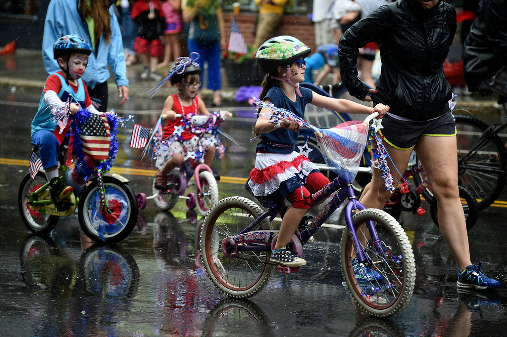 Description of . Kayla Rice/Reformer Children ride their bikes, decorated for the holiday, in the Brattleboro Fourth of July parade on Friday.