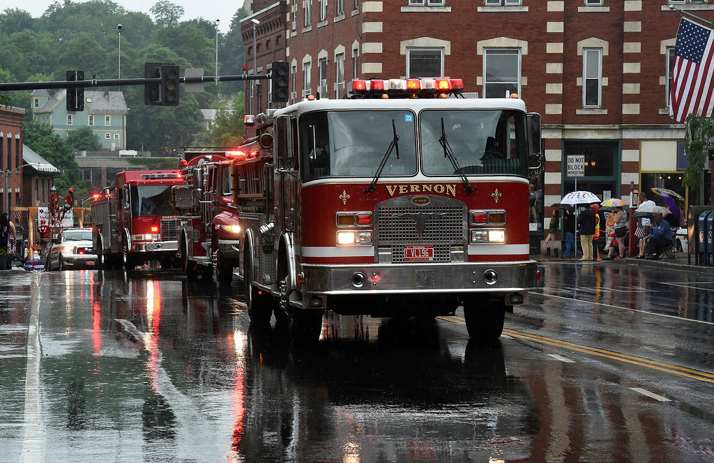 Description of . Kayla Rice/Reformer Local fire trucks make their way up the Brattleboro Fourth of July parade route on Friday.