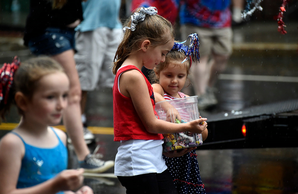 Description of . Kayla Rice/Reformer Girls prepare to throw candy while walking in the Brattleboro Fourth of July parade on Friday.