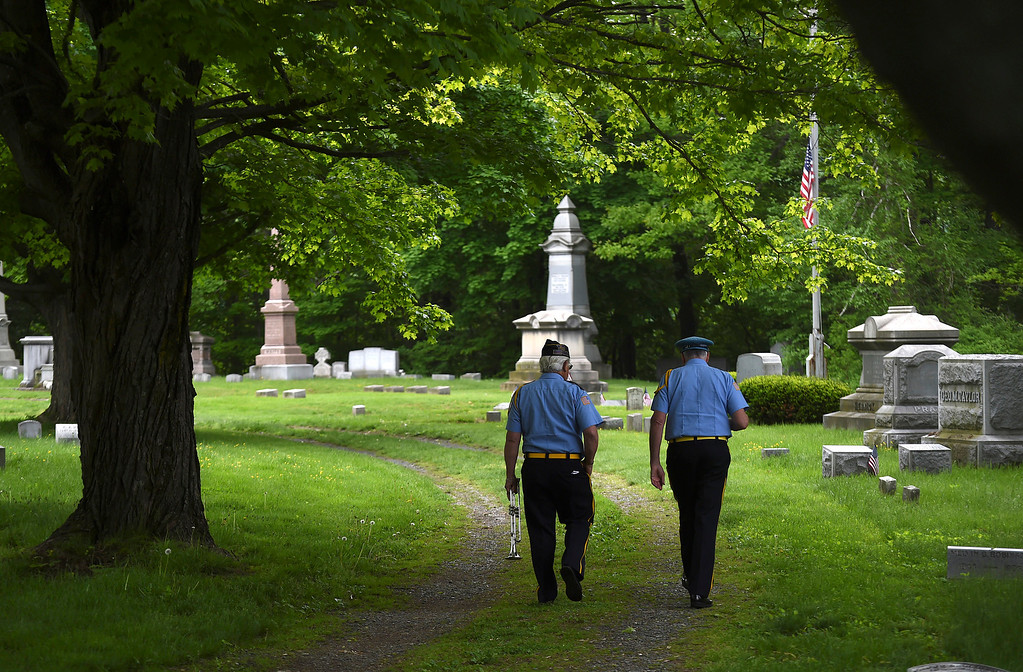 Description of . Kayla Rice/Reformer Members of the American Legion Post 5 band walk in to the Prospect Hill cemetery before the Memorial Day Service there on Monday morning.