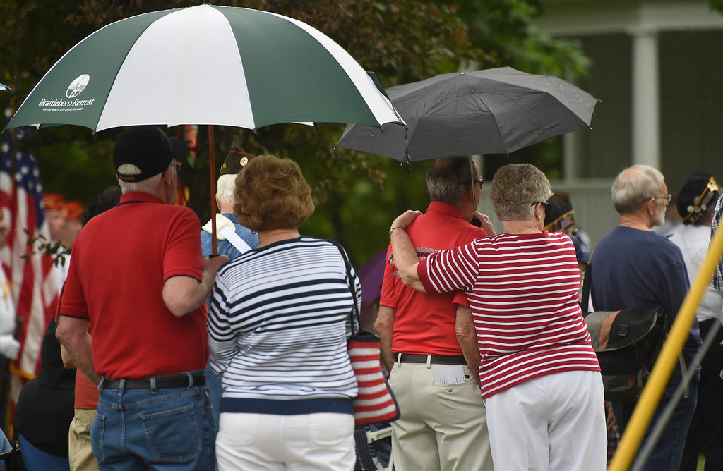 Description of . Kayla Rice/Reformer People gather under umbrellas during the Memorial Day service at the Brattleboro Common on Monday morning.