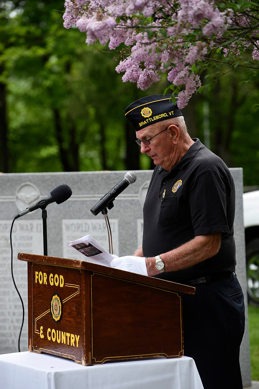 Description of . Kayla Rice/Reformer Past Commander of American Legion Post No. 5 Richard Guthrie speaks during the Memorial Day service at the Brattleboro Common on Monday morning.