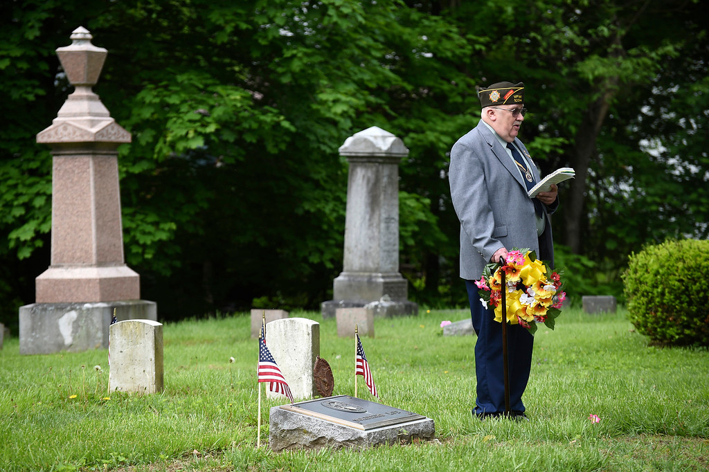 Description of . Kayla Rice/Reformer American Legion Post 5 chaplain E. David Wright speaks during the wreath-laying ceremony at the Memorial Day service in Brattleboro's Prospect Hill cemetery on Monday morning.