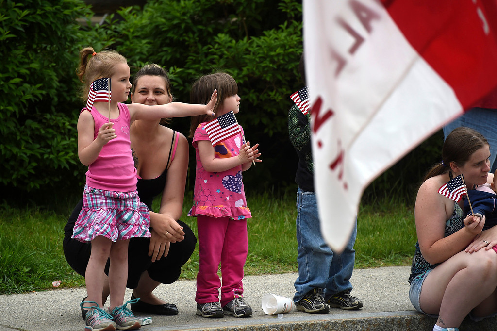 Description of . Kayla Rice/Reformer Rebecca Paligo of Brattleboro stands with her daughter and niece Hayla and Maddison Paligo, both 4, while watching the Hinsdale Memorial Day parade on Monday morning.