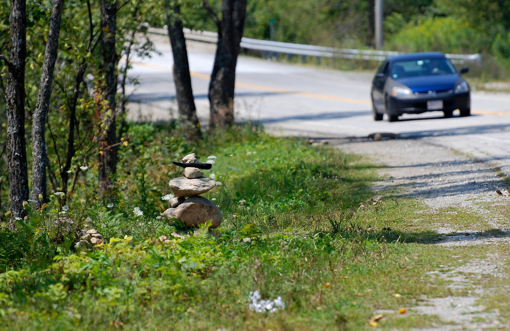 Description of . Kayla Rice/Reformer                                 A cairn on Route 30 in Jamaica.
