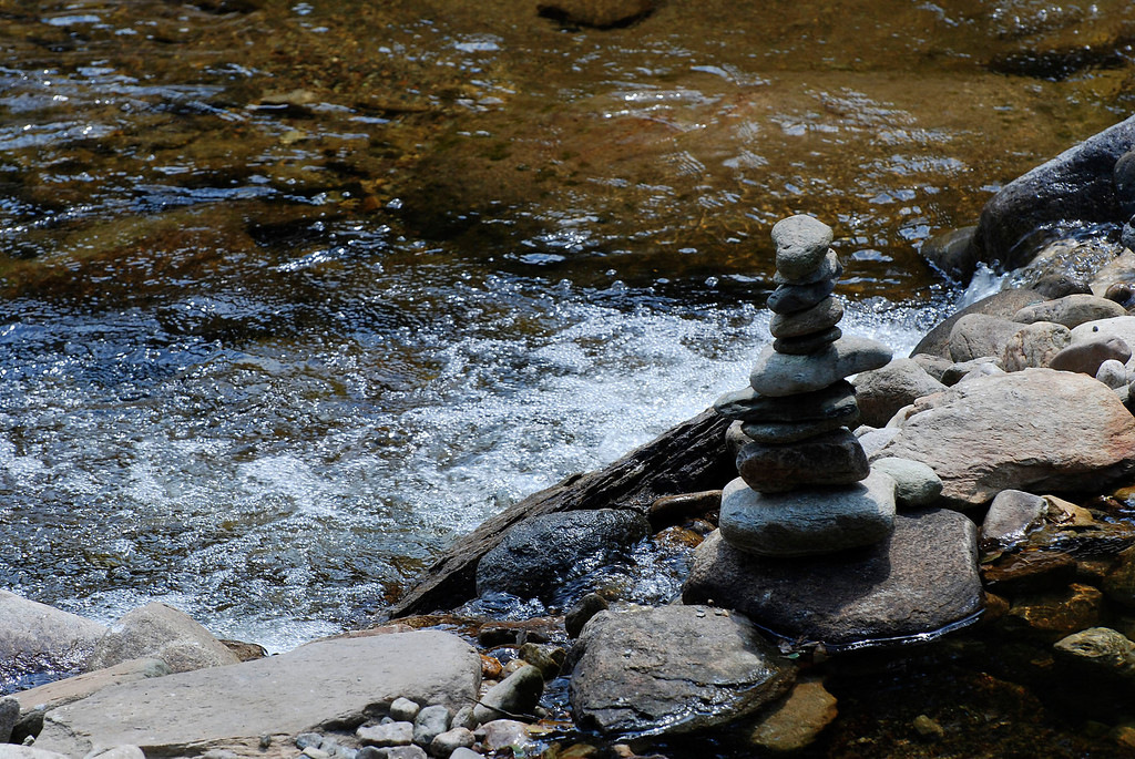 Description of . Kayla Rice/Reformer                                 A cairn in the river on Route 30 in Jamaica.