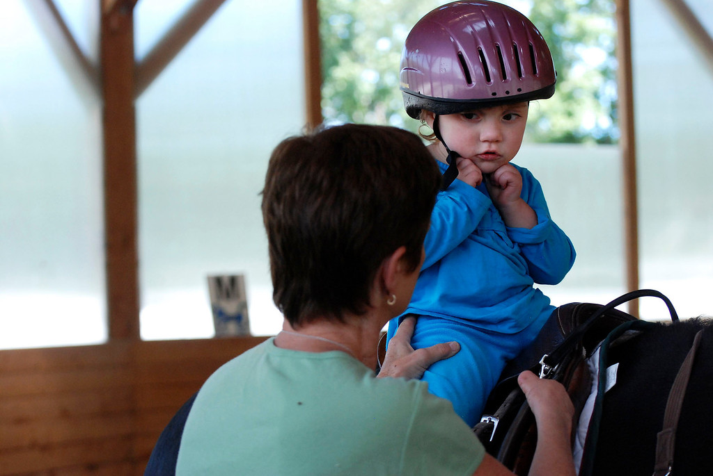 Description of . Kayla Rice/Reformer                                 Lexi Leland, 3, listens to Program Director Lorna Young during her weekly horse therapy at Winchester Stables in Newfane.