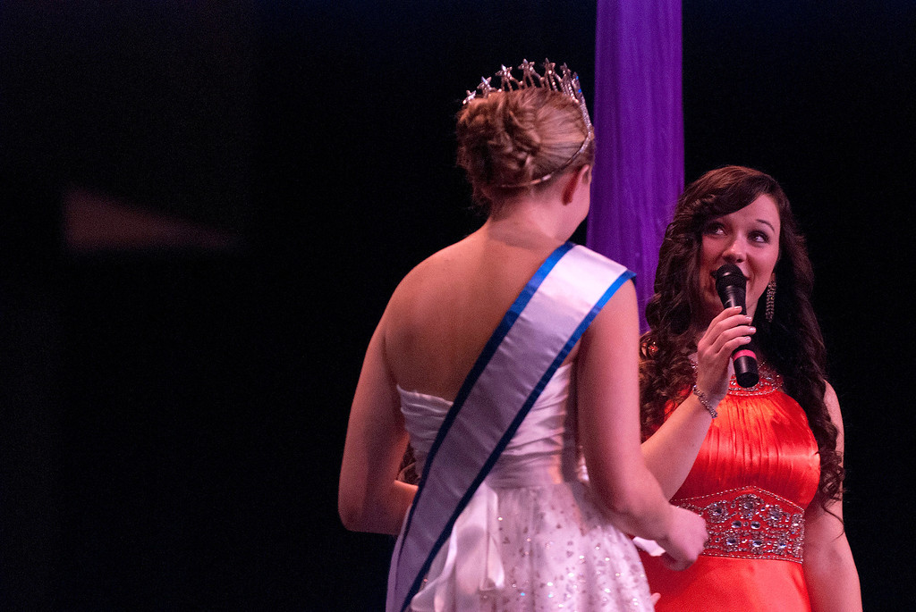 Description of . Kayla Rice/Reformer Katelyn Donovan answers a question during the 2014 Winter Carnival Queen's Pageant on Friday evening.