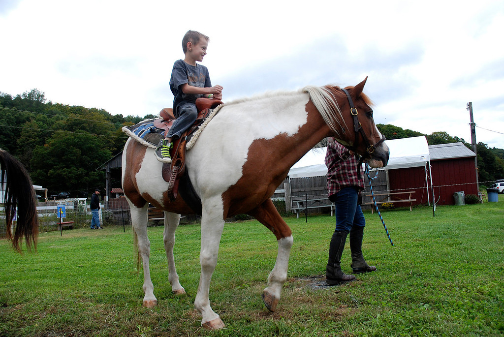 Description of . Kayla Rice/Reformer Weston Clark, 6, of Ashfield, Mass. rides a horse at Gaines Farm in Guilford.