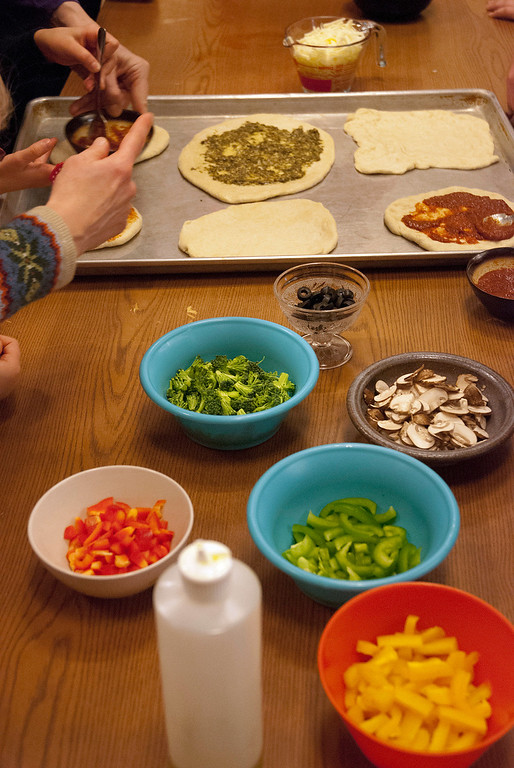 Description of . Kayla Rice/Reformer Children were able to cover their pizza crusts with whichever toppings they desired during a cooking class held at the Brattleboro Food Co-Op for the Winter Carnival on Friday afternoon.