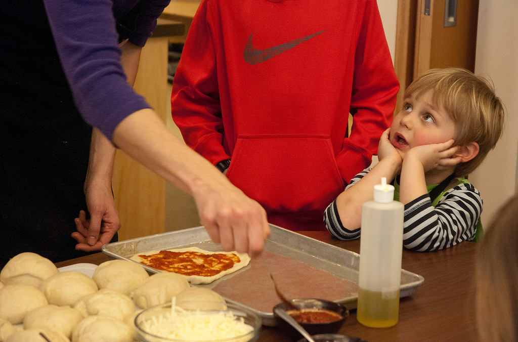 Description of . Kayla Rice/Reformer Rowan Carse, 3, of Brattleboro asks a question during a cooking class held at the Brattleboro Food Co-Op for the Winter Carnival on Friday afternoon.