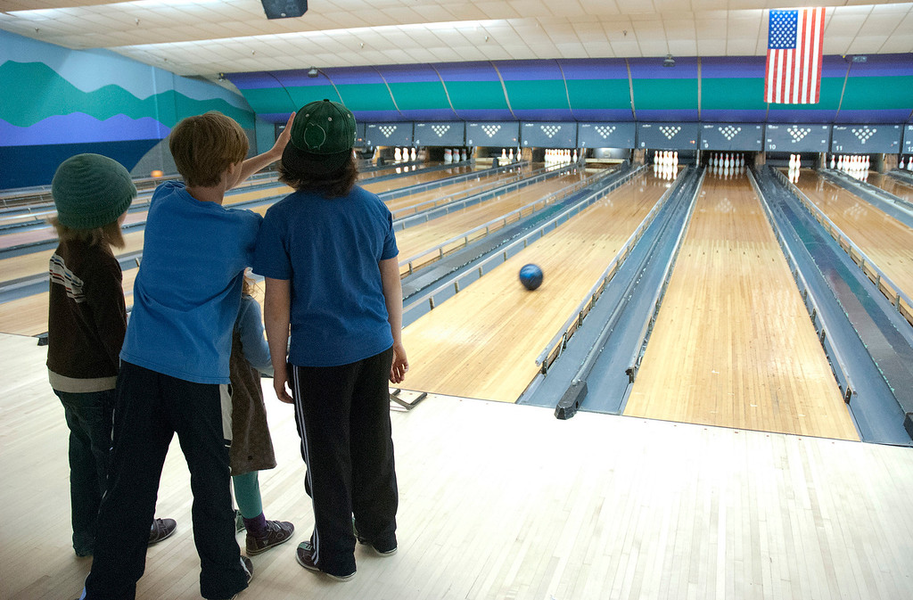 Description of . Kayla Rice/Reformer Children work together while bowling at Brattleboro Bowl on Tuesday afternoon.