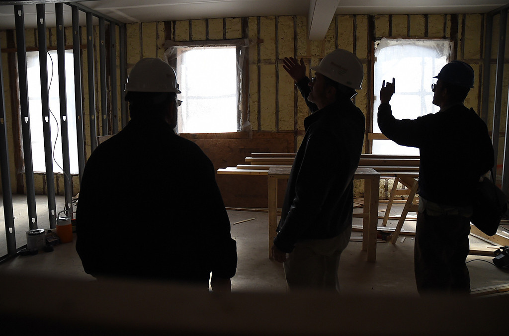 Description of . Kayla Rice/Reformer Bob Stevens of Mesabi LLC gives members of the media a tour of the Brooks House to show the progress of the historic building's re-construction on Thursday afternoon.