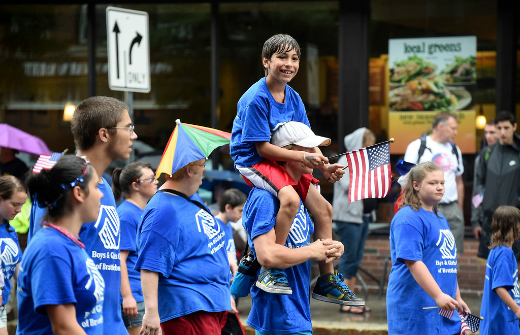 Description of . Kayla Rice/Reformer People representing the Boys & Girls Club walk in the Brattleboro Fourth of July parade on Friday.