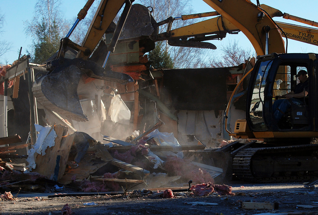 Description of . Kayla Rice/Reformer Tyler Excavating works to demolish what was once Hinsdale Greyhound Park. The race track opened for horse racing in 1958 and closed in 2008 after transitioning to a greyhound race track.