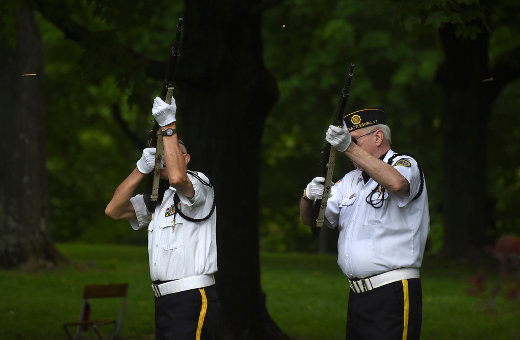 Description of . Kayla Rice/Reformer Members of the Brattleboro VFW honor guard shoot their rifles into the air during the Memorial Day service at the Brattleboro Common on Monday morning.