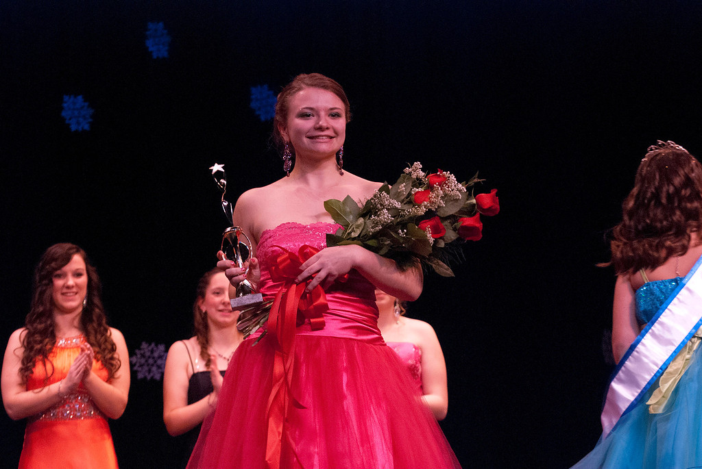 Description of . Kayla Rice/Reformer 2nd runner up Marissa Semenovich smiles during the 2014 Winter Carnival Queen's Pageant on Friday evening.