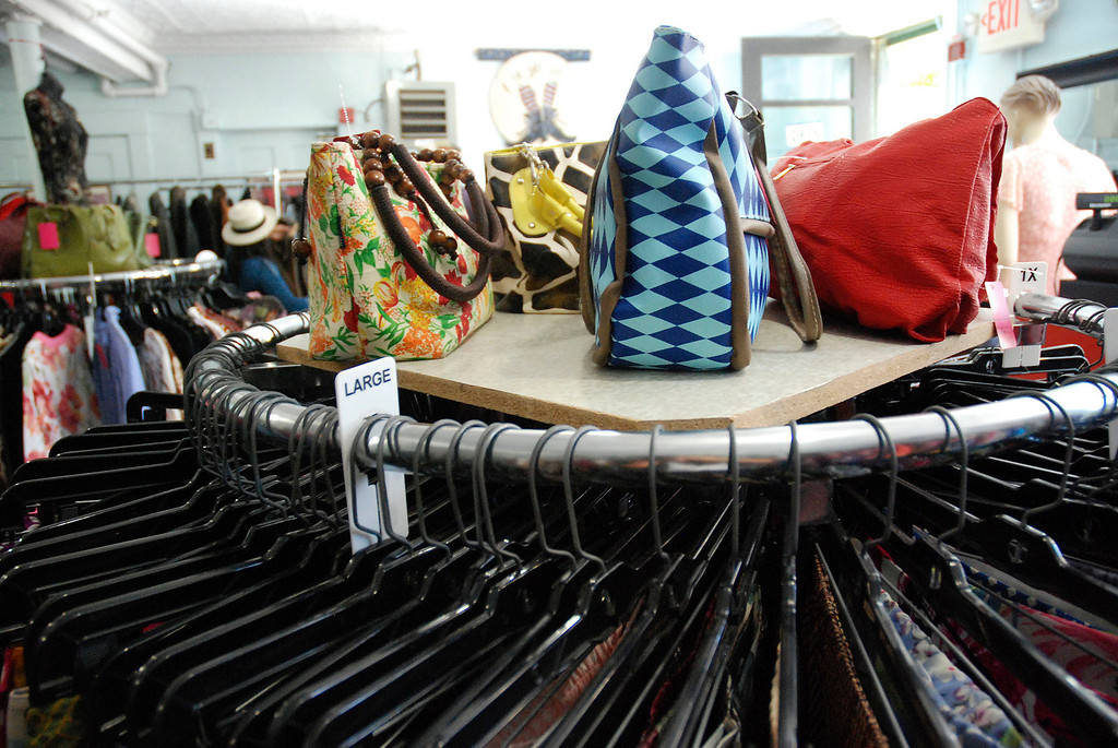 Description of . Kayla Rice/Reformer Colorful bags and clothing fill El Sol Boutique on Main St. in Brattleboro.