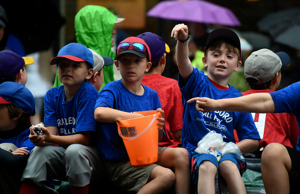 Description of . Kayla Rice/Reformer Brattleboro Small Fry players throw candy in the Brattleboro Fourth of July parade on Friday.