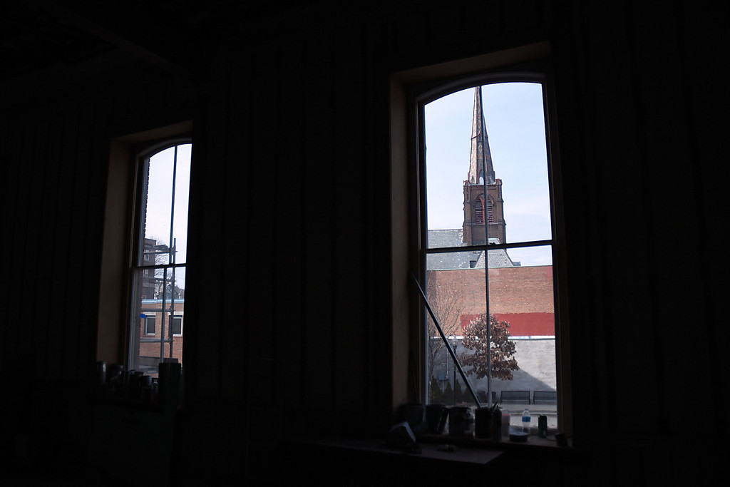 Description of . Kayla Rice/Reformer Downtown Brattleboro seen from inside the Brooks House.