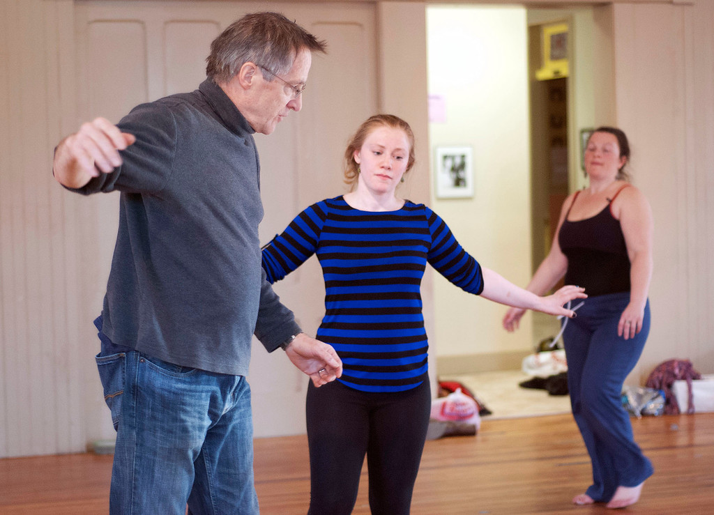 Description of . Kayla Rice/Reformer                                 IBIT (Intrinsic Beauty of Invisible Things) instructor Donlin Foreman gives dancers Genevieve Amarante (left) and Brenda Lynn Siegel help during a rehearsal at their Elliot St. studio in Brattleboro on Tuesday afternoon.