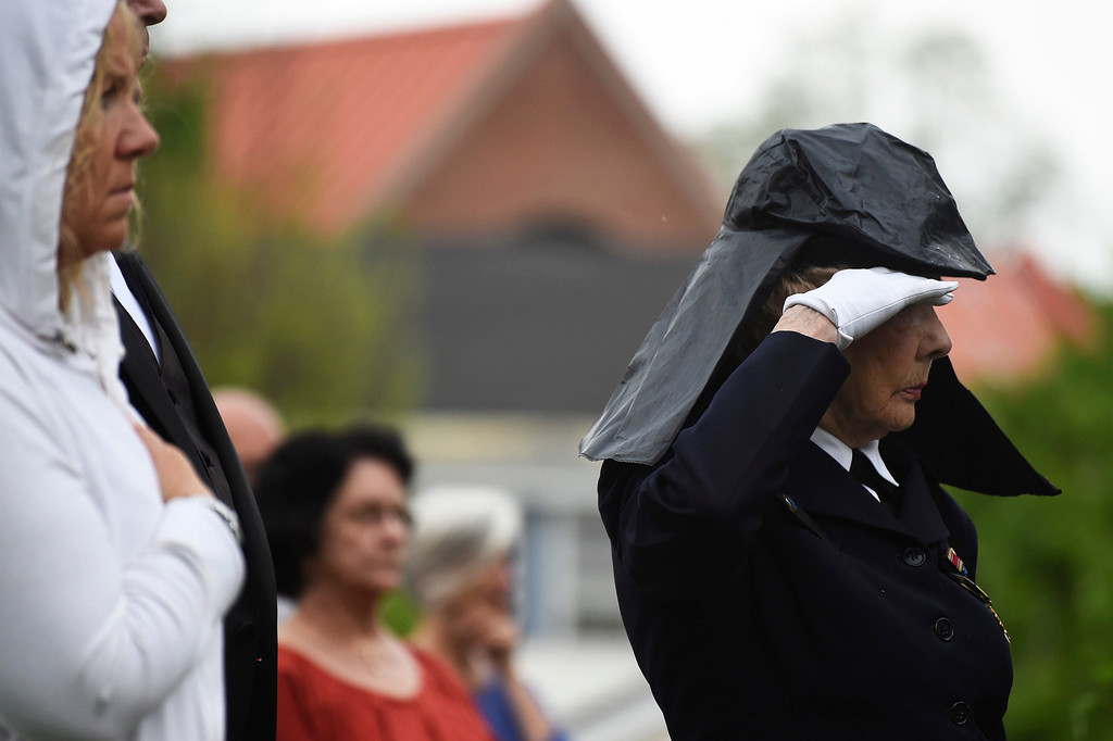 Description of . Kayla Rice/Reformer State Director of the Green Mountain WAVES (Women Accepted for Voluntary Emergency Service) Jane McCauley salutes during the Memorial Day service at the Brattleboro Common on Monday morning.