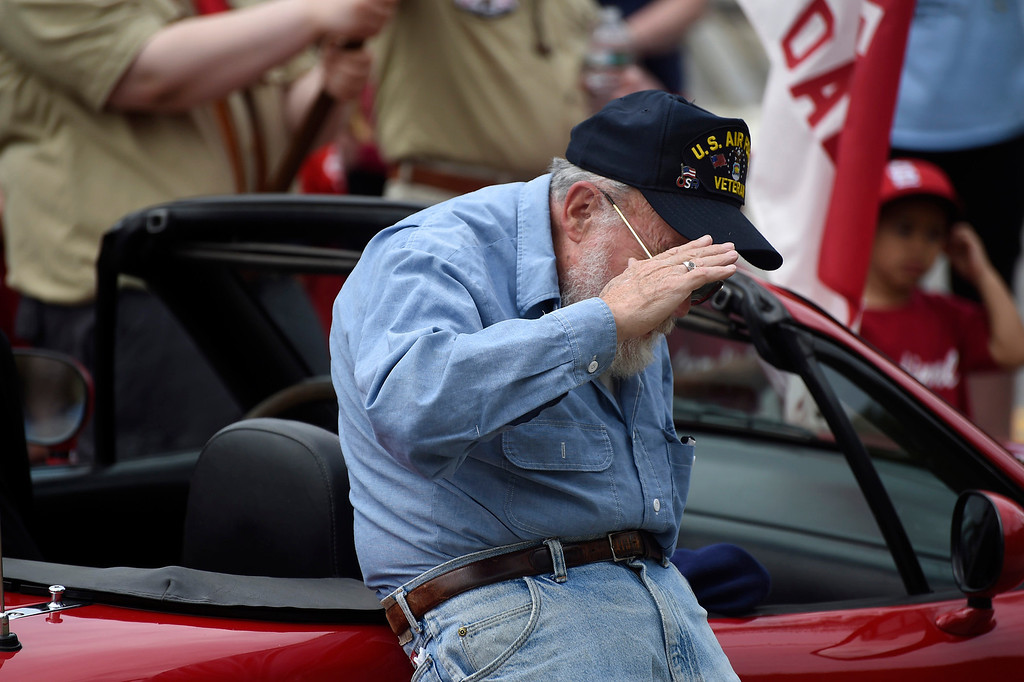 Description of . Kayla Rice/Reformer Air Force veteran Dwight Blossom salutes during the raising of the flag at the Hinsdale VFW after the Hinsdale Memorial Day parade on Monday morning.