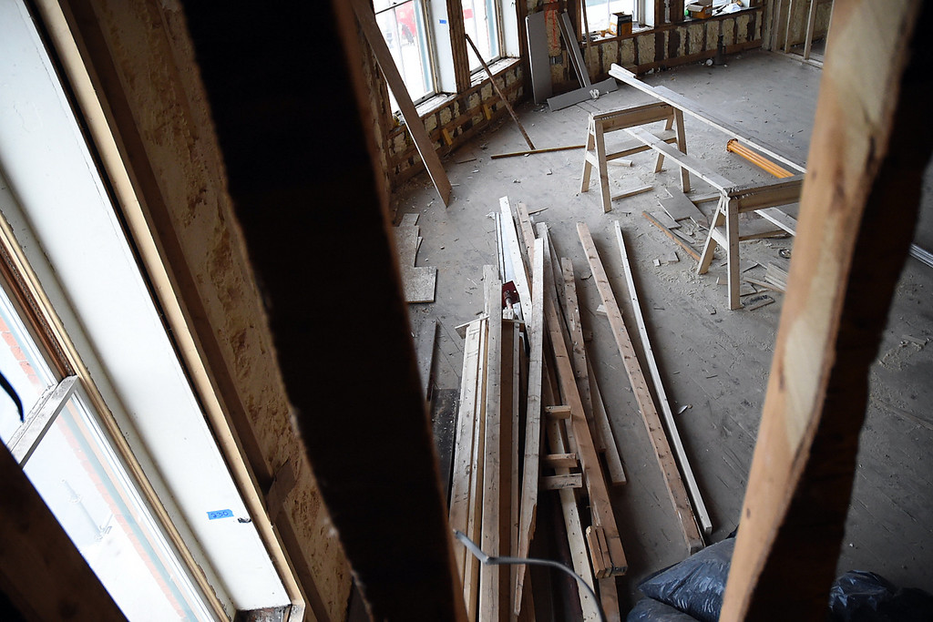 Description of . Kayla Rice/Reformer Piles of boards lie around the unfinished rooms in the Brooks House.