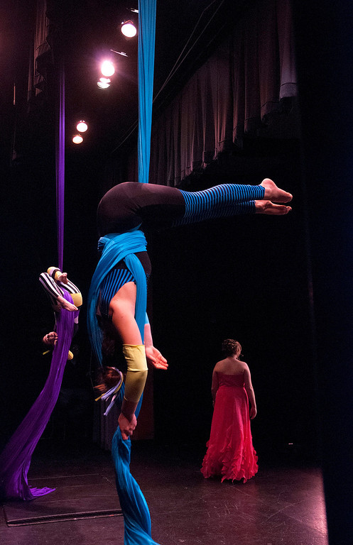 Description of . Kayla Rice/Reformer Performers from the New England Center for Circus Arts add to the spectacle of the evening gown portion of the 2014 Brattleboro Winter Carnival's Queen's Pageant on Friday night.