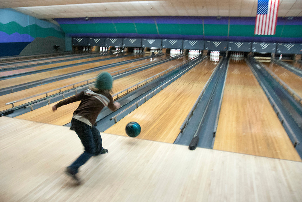 Description of . Kayla Rice/Reformer Kailo Coursen, 8, of Guilford bowls at Brattleboro Bowl on Tuesday afternoon.