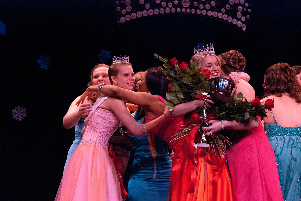 Description of . Kayla Rice/Reformer Contestants hug after Kara Walsh was crowned as the 2014 Winter Carnival Queen on Friday evening.