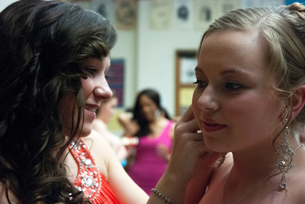 Description of . Kayla Rice/Reformer Katelyn Donovan helps Katie Burroughs with an earring before the evening gown portion of the 2014 Brattleboro Winter Carnival's Queen's Pageant on Friday night.