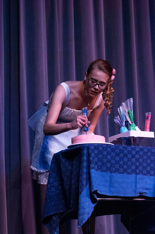 Description of . Kayla Rice/Reformer Nicole Koziara decorates a cake for the talent portion of the 2014 Brattleboro Winter Carnival's Queen's Pageant on Friday night.