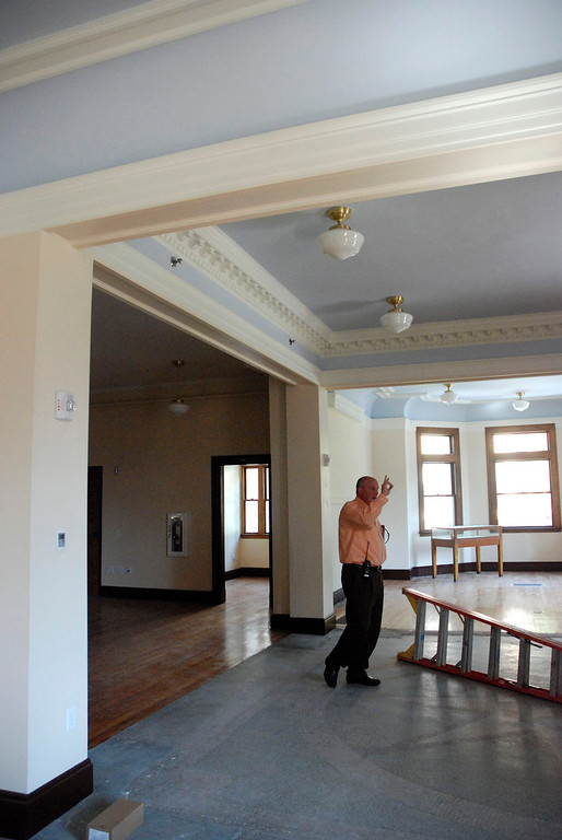 Description of . Kayla Rice/Reformer                                 Municipal manager, Chip Stearns talks about renovations at the Rockingham Public Library in Bellows Falls.