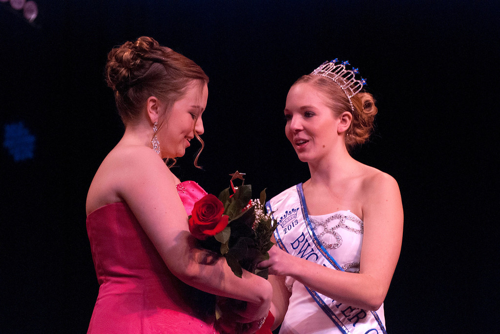 Description of . Kayla Rice/Reformer Katie Burroughs is congratulated by 2013 Winter Carnival Queen Alison Cornellier after being announced as the runner up during the Queen's pageant on Friday evening.