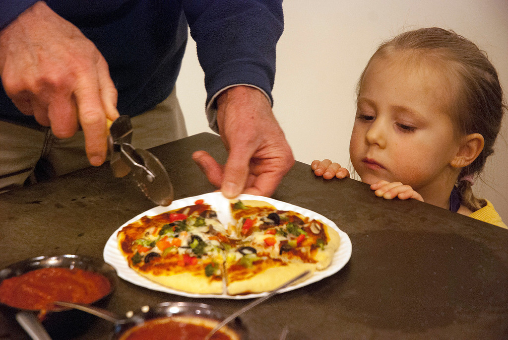Description of . Kayla Rice/Reformer Lupin Norrichs, 3, of Brattleboro looks on as her pizza is cut. Norrichs participated in the pizza cooking class as part of the Winter Carnival at the Brattleboro Food Co-Op on Friday afternoon.
