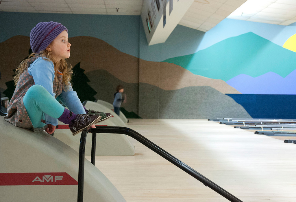 Description of . Kayla Rice/Reformer Ocea Coursen, 4, of Guilford sits and watches her brother bowl at Brattleboro Bowl on Tuesday afternoon.