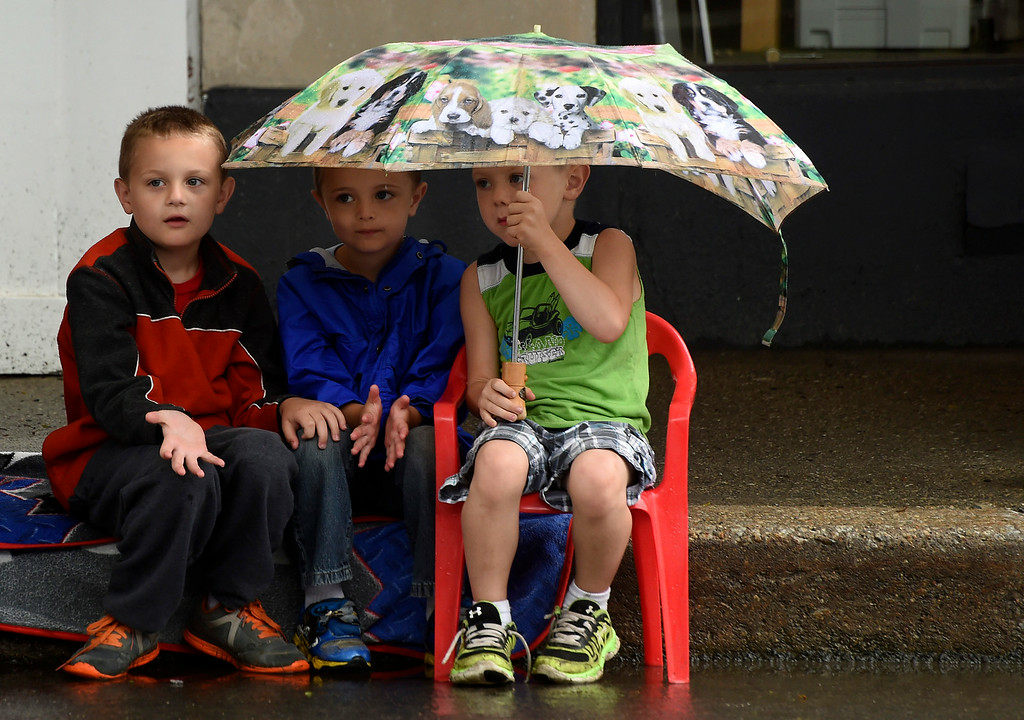 Description of . (L-R) Connor Buker, 8,  Bradon Hall, 5, and Jacob Buker, 5, of Brattleboro wait for the Brattleboro Fourth of July parade to begin on Friday.