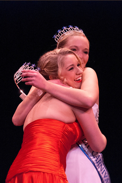 Description of . Kayla Rice/Reformer 2013 Winter Carnival Queen Alison Cornellier passes on the crown to Kara Walsh during the 2014 Brattleboro Winter Carnival Queen's Pageant on Friday evening.