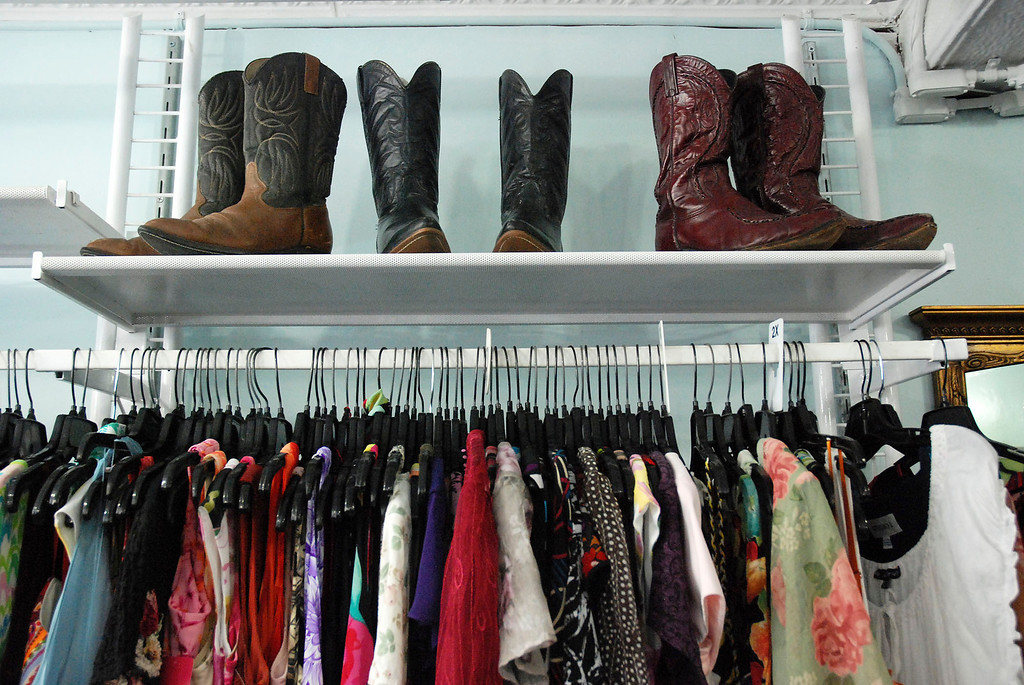 Description of . Kayla Rice/Reformer Cowboy boots and colorful clothing fill El Sol Boutique on Main St. in Brattleboro.