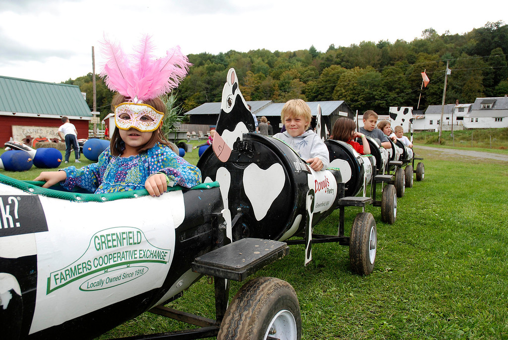 Description of . Kayla Rice/Reformer Children ride the cow train at Gaines Farm in Guilford.