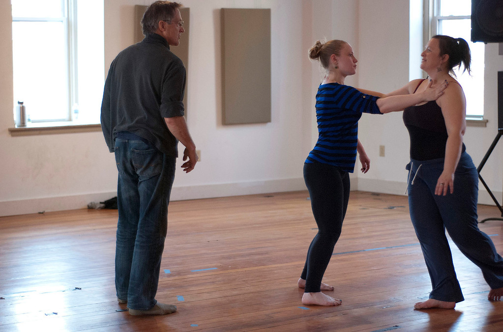 Description of . Kayla Rice/Reformer                                 IBIT (Intrinsic Beauty of Invisible Things) instructor Donlin Foreman gives dancers Genevieve Amarante and Brenda Lynn Siegel help during a rehearsal at their Elliot St. studio in Brattleboro on Tuesday afternoon.